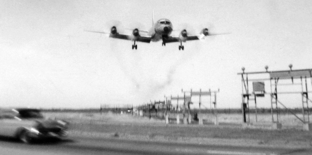 a009e1c0db0a A circa 1965 photo by Gary Jones of an American Airlines Lockheed Electra on  final for GSW over Highway 183.